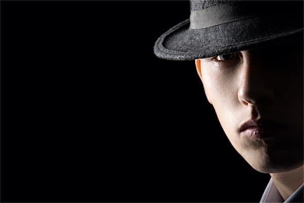 Understanding Low Key Lighting Example: Portrait of young man in hat
